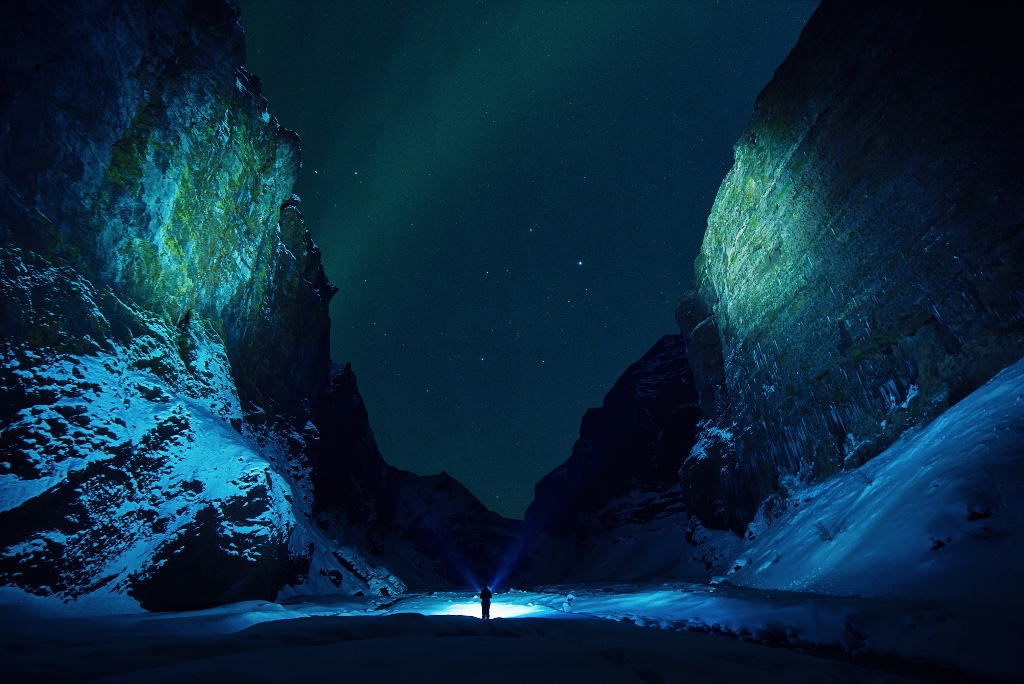 person walking at night in beautiful canyon